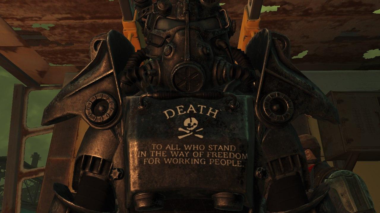 """En en 'Ultimate Anarchist mode' de Fallout 4 podemos, incluso, personalizar nuestra servoarmadura con el lema del Territorio Libre de Majnovia: """"Muerte a todos los que se ponen en el camino de la libertad del pueblo trabajador"""""""